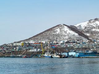 View of fishing boats standing near the shore in Avchinskaya Bay in Petropavlovsk-Kamchatsky, Russia
