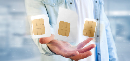 Businessman holding Different size of a smartphone sim card 3d rendering