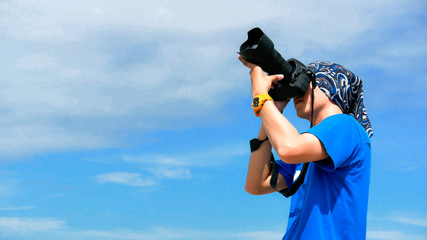 Photographer on blue sky background.