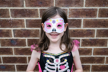 Young girl dressed for halloween in a day of the dead costume