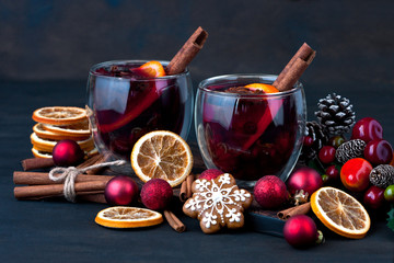 Christmas hot drink in glass and gingerbread cookies