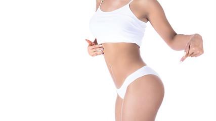 sexy slim woman in underwear on white background. Showing on her buttocks.