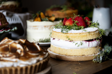 Table filled with homemade cakes