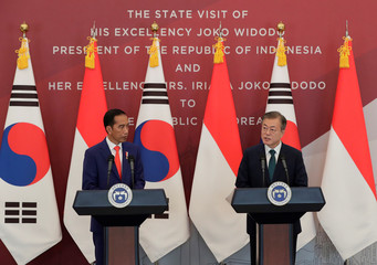 South Korean President Moon Jae-in and Indonesian President Joko Widodo hold a news conference at the presidential Blue House in Seoul
