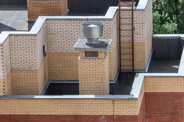 Ventilation pipe on the roof of the building