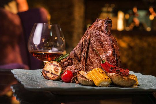 Grilled t-bone steak with grilled vegetables