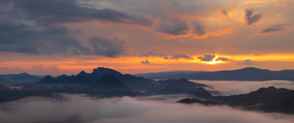 Wall Mural - wonderful, beautiful sunset in the mountains. The fogs were illuminated by the setting sun