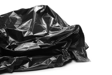 Black garbage bag roll isolated on white background