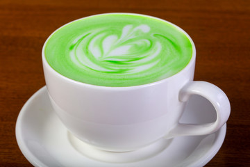 Green cappuccino with cream