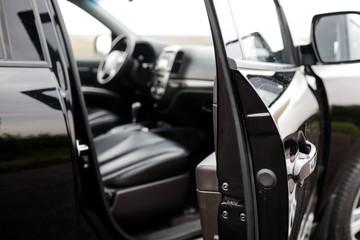 Modern luxury prestige car interior, dashboard, steering wheel.