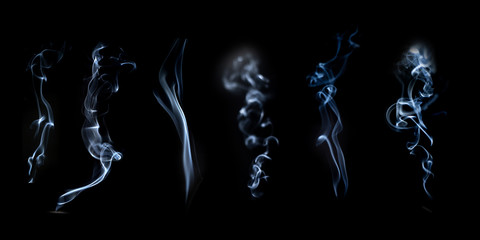 Smoke or fog steam set on black color background . Hazy steam curls for decorative special effect . Cigarette fumes or dry ice Smoking design.