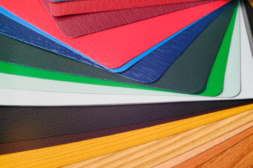 Samples of the colored lamination. The color palette on the table