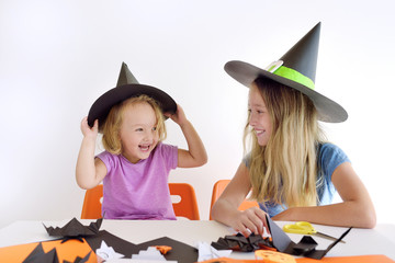 Two kids in carnival costumes for Halloween.
