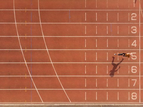 Female athletic running on sports track