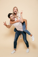 Full length portrait of a cheerful young couple