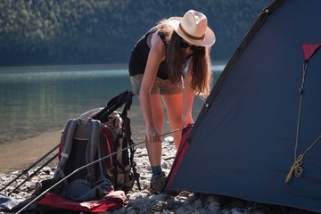 Woman setting up tent