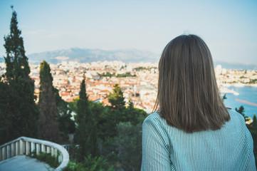 Woman enjoying views of the old town of Split.