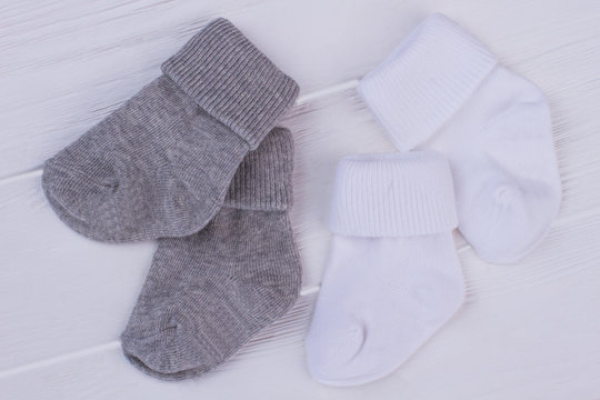 Two pairs of grey and white socks.