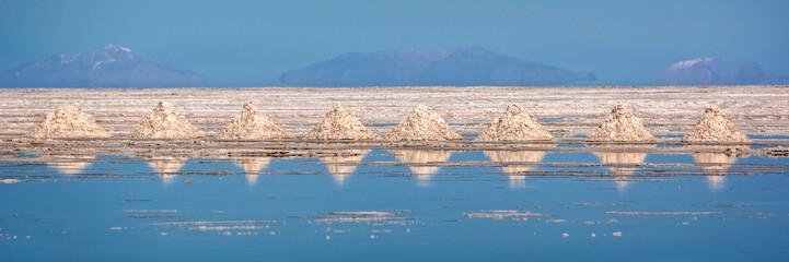 Panorama of piles of salt aligned in Salar de Uyuni (Uyuni salt flats), Potosi, Bolivia