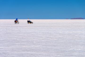 Cyclists in Salar de Uyuni (Uyuni salt flats), Potosi, Bolivia