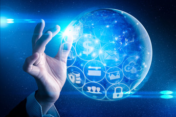 The abstract image of the businessman hold the futuristic hologram on hand and element of this image furnished by Nasa. the concept of communication network, cyber security and internet of things.
