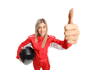 Female racer making a thumb up sign