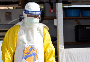 A medical worker wears a protective suit as he prepares to administer Ebola patient care at The Alliance for International Medical Action (ALIMA) treatment center in Beni