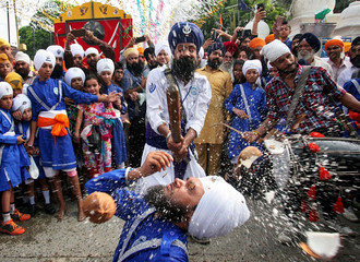 Sikh devotees perform Gatka, a traditional martial arts form during celebrations to mark the 414th anniversary of the installation of the Guru Granth Sahib, the religious book of Sikhs, in Amritsar