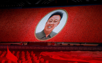 Participants form portrait of Kim Jong Il during Mass Games in May Day stadium marking the 70th anniversary of North Korea's foundation in Pyongyang