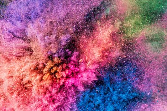 Colorful holi powder blowing up.