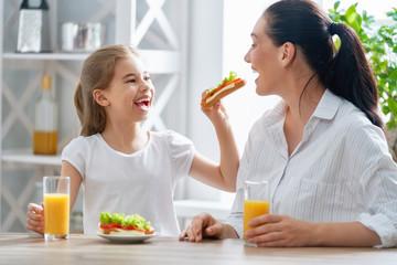 Happy family having breakfast.