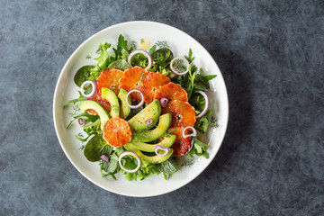 Avocado and Blood Orange Salad with Fennel and Purple Onions Over Mixed Greens on Plate