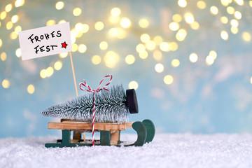 Weihnachtsbaum mit Schlitten holen