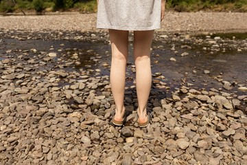 Woman standing near stream at countryside