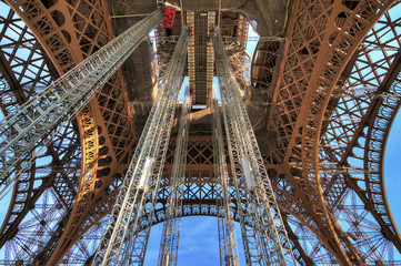 Beautiful view of the Eiffel tower seen from beneath in Paris