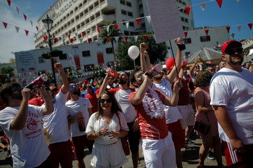 People gather at Casemates square during the Gibraltar National Day celebrations, in the British overseas territory of Gibraltar