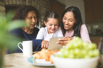 Family using digital tablet at home
