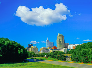 A nice cityscape of downtown Raleigh North Carolina with an interesting cloud in the sky above.
