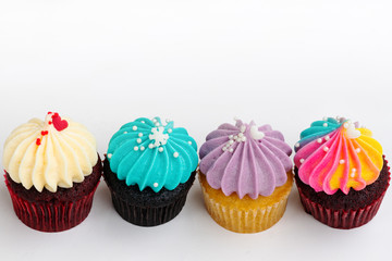 variety colorful cute cupcake on white background