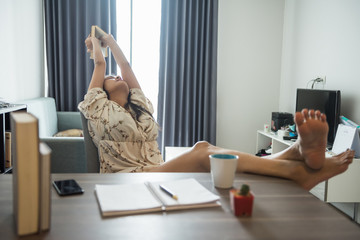 Woman stretch body during reading book