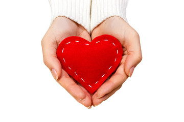 girl hands giving red heart top view isolated