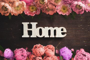 """word """"home"""" on wooden background with many flowers"""