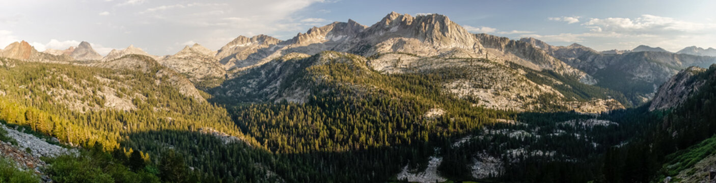 Wide granite valleys at sunset in California's Sierra Nevada along the John Muir Trail