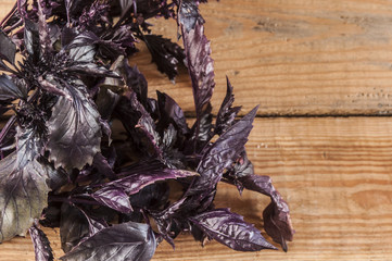 bunch of purple basil on a wooden table