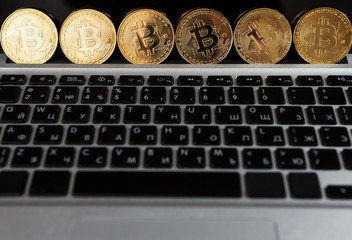 Bitcoin coin symbol on laptop future concept financial currency crypto currency sign
