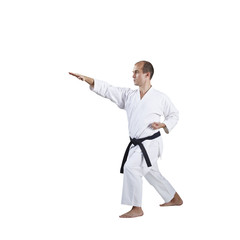 On a white background, formal exercises of karate are trained by an adult athlete