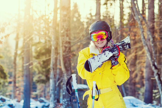 winter portrait of beautiful girl with sunglasses. skier in the woods. close-up