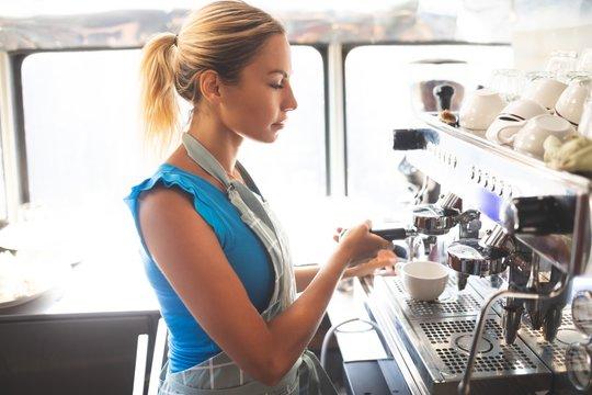 Woman waitress preparing coffee