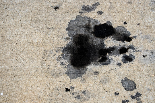 Motor oil stains on concrete pavement/texture background