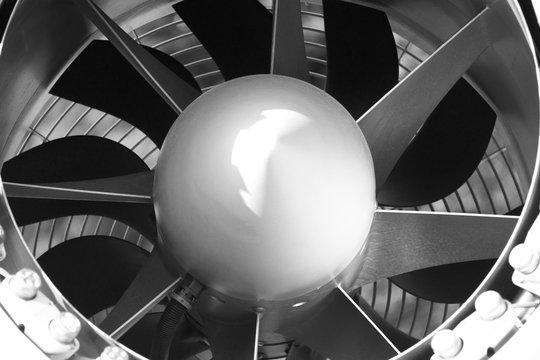 blades of a huge fan, a turbine in the ventilation shaft